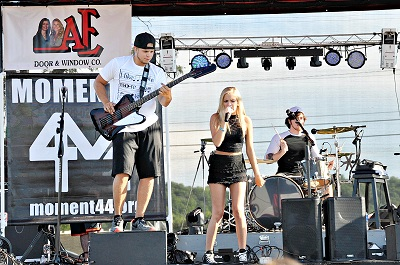 The band, Moment 44, playing live music at The Sacred Heart Fesival